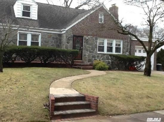 Wideline Cape With Rear Dormer On Parklike Property. Updated Kitchen With S/S Appliances,  H/W Floors,  Living Rm With Stone Fireplace,  Lg Fdr,  Family Rm. Central Air,  Gas Heat & Cooking.