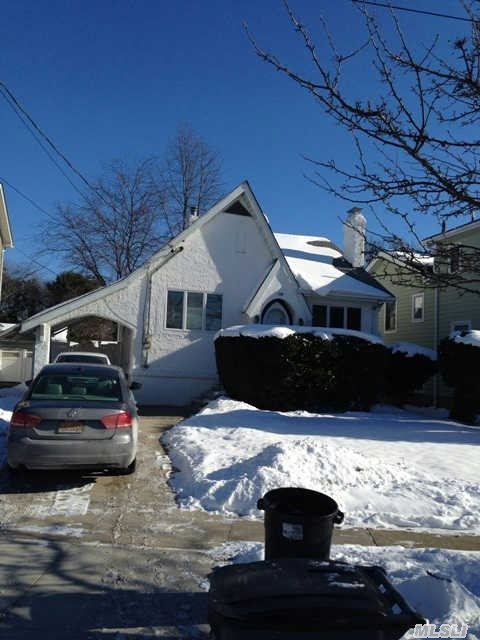 Currently Used As An Illegal In-Law With Shared Kitchen,  Separate Side Entrance,  And Full Bathroom And Fireplace In Basement. Kitchen Is Between Upstairs And Basement With Locking Door Between Spaces.