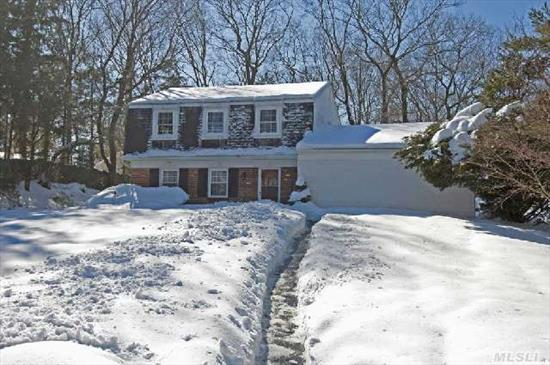 Comfortable Colonial Offers 3 Br,  3.5 Bths With Studio. Den W/Fplc Or Perfect For Home Office W/Side Entrance. Private .52 Acre. Oak Floors,  Central Air,  In Ground Sprinklers. Great Buy In Three Village! New Baths,  Floors In Bedrooms- A Must See- Taxes Are Being Grieved