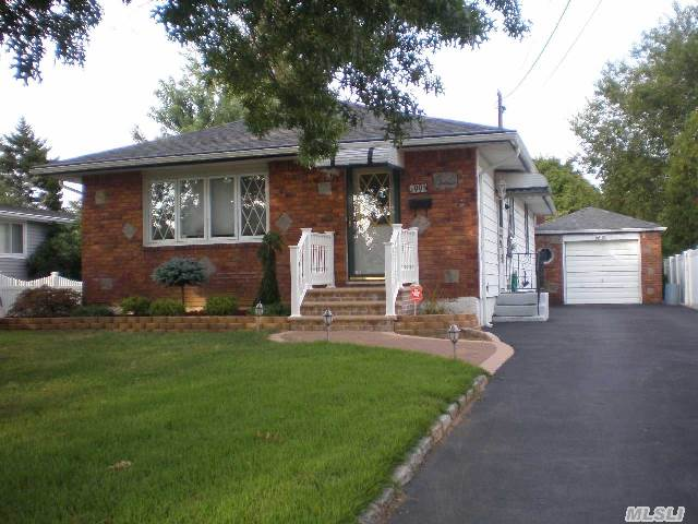 Great Curb Appeal,  Wonderful 1st Home With Open Floor Plan,  Hardwood Floors,  New Carpet,  Updated Windows,  Kitchen And Roof,  Skylight In Full Bath,  Ceiling Fans In All Rooms. Bright And Airy Home. Close To All Schools,  Lirr Deer Park Station & Shopping.