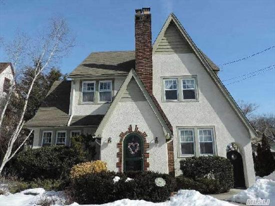 Charming Tudor On Tree Lined Street In Award Winning Sd. 20. F/P In L/R-Beautiful Oak Floors,  Crown Molding,  Lovely Maple Kitchen With Breakfast Room,  Large Deck With Electric Overlooking Beautiful Yard.  Walk-Up Attic Is Unfinished But Has Heat And Electric And Easily Finished.