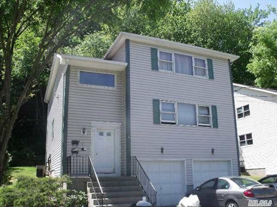 Make Money At Home!! Live In One Rent The Other.....Legal 2 Family Each Unit Has 3 Bdrms,  2 Baths,  Cac,  Sep Heating,  Large Lr,  Eik,  Oak Floors,  Garage,  Deck Off Master,  Master Bath And Hall Bath.  Lovely Area,  Near All The Glen Cove  Has To Offer.  Schools,  Shopping,  Beaches,  Parks And Golf!   Come See,  Come Sigh Come Buy.
