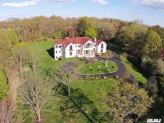 Stunning Brick Colonial Set Behind Private Gated Driveway On 3 Acres Of Flat,  Landscaped Property. The Residence Boasts All The Amenities Of Luxury Living With 8 Bedrooms Including 3 Master Suites W/ Jacuzzi Tub,  Solar Heat For All Water & Radiant Heat On 1st Floor & All Baths. Finishedlower Level With Lap Pool,  Sauna & Gym.