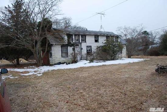 4.6 Acre Residential Parcel With Large,  Old Farmhouse In Very Poor Condition.  Public Water And Electricity.  Sold Completely As Is  Without Any Representations As To Sub-Division,  Property Restrictions,  Etc.  Buyer Must Do Due Diligence.  Enter At Own Risk.  260 Feet Of Frontage.  1.5 Acres Cleared.