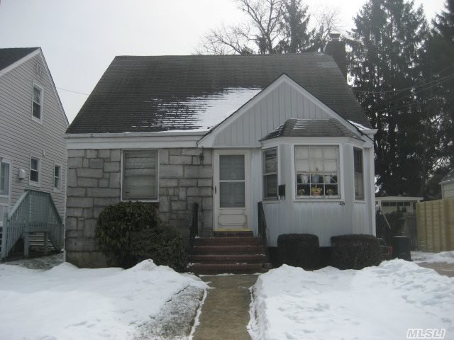 Cozy Cape Located On A Quiet Block In The Desirable Presidential Area. Hardwood Floors,  3 Bedrooms On 2nd Floor. Needs Tlc. Priced To Sell. Great Value