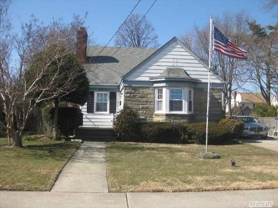 Just What You're Looking For! Spacious Home With Great Yard-No Storm Damage & Mid   Block Location.Sunny Fieldstone Colonial Cape On 60 X 140 Ppty.Living Rm W/ Wood Burning Fireplace, Fdr, Eik, 3 Bdrms W/2 King Size-One On Main Level & Other Upstairs + 2 Fbths.Huge Bsmt W/High Ceilings & Tons Of Storage.Newer Roof & Gas Boiler-New Hot Water Heater-All Vinyl Windows-Near All