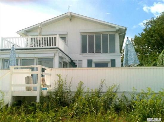 A Serene And Tranquil Location With Panoramic Views Of The Long Island Sound.  Enjoy This Fabulous Home Perfect For Family Life And Entertaining.. The Open Floor Plan Will Showcase One Of A Kind Sunsets. This Home Has A Separate Guest Cottage Equipped With Kitchen/Bath Separate Heat And Air.  Amenities Abound In This Stunning Waterfront Home!  Perfect For Any Family!