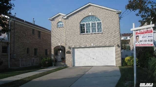 Custom Built 2002 Solid Brick Four Bedroom, Three Bath 43X122 Lot Waterside Estates Colonial In A Very Private Area Of Whitestone, New Kitchen, Stainless Steel Appliance, Granite, Formal Livingroom With Fireplace, Diningroom, Familyroom, Masterbed With Walk In Closets,  Three Updated Baths, Hardwood Floors,  Huge 8 Foot Ceiling Basement, Side Entrance, Two Car Garage, , Beach Rights