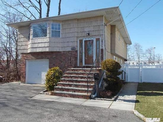 Lovely Hi-Ranch W/Fin.Bsmt/Beautiful 20X40 Inground Pool W 2Yr Oldpavers/2 Decks, 2nd Flr Deck Wraps  Around/Cac/Cvac/Gas Heat & Cooking/Laundry Rm/ Igs/Hardwood Floors On Both Levels/Sep.Hw Heater.