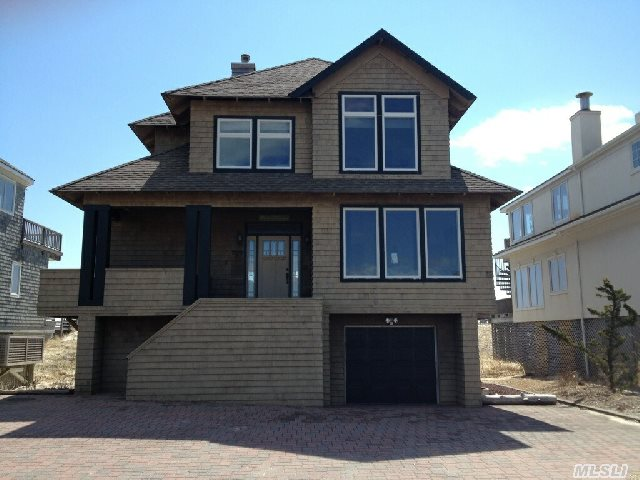 Don't Miss This Oceanfront Home With Right Of Way To The Bay  Open Floor Plan  Fabulous Views  Brand New Custom Kitchen Living Room With Fireplace 4 Bedrooms 4 Full  Baths  Master Bedroom Suite With Private Balcony Large Deck With New Hot Tub Private Walkway To The Beach  Great Home For Entertaining