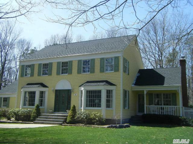 Spacious & Gracious Colonial. Diamond Condition. Private Acre In The Pristine Comm. Of Wading River Acres. Many Upgrades Inc. Roof,  Burner,  Granite Counters & Ss Appl In Kit.,  Updt.Baths W/Decorative Tile & Vanities,  Oak Fls,  Custom Moldings,  Den W/Br. Fpl,  Cent Ac & Whole House Fan. Entertain In The Sunroom,  The Deck,  The Bsmt Playroom Or Cool Off In The Ig Pool Swr Sd.