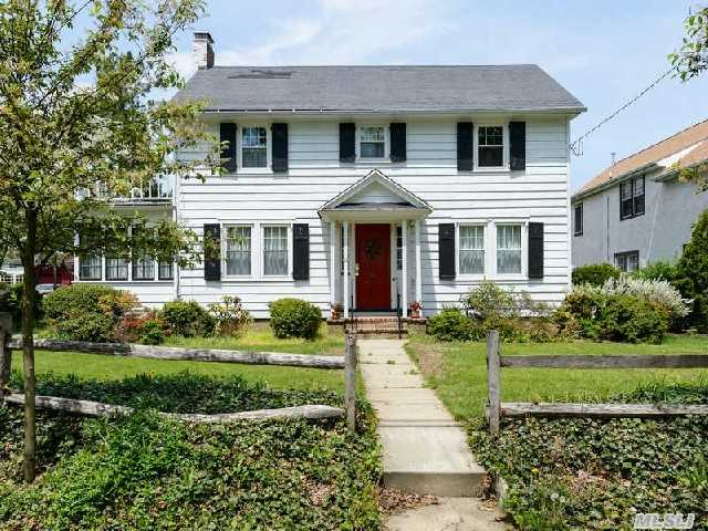 Sunny Classic Center Hall Colonial With Spacious Yard. Southern Exposure! Great Curb Appeal. Charm Abounds Throughout. Living Room W/Fireplace,  Formal Dining Room,  Den,  Eik. Master Bedroom W/Adjoining Porch. Hardwood Floors. 2 Car Detached Garage. Close To Houses Of Worship And Shopping.