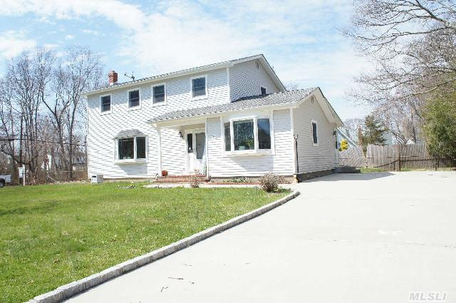 This Large Colonial In Beautiful Holiday Beach Features: New Roof,  Siding,  Anderson Windows,  New Heating System,  Gleaming Hardwood Floors,  4 Large Bedrooms,  Full Basement,  Fenced In Yard,  Deeded Beach And Boating,  Clubhouse,  Close To All!!!