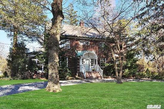 Location,  Location!  Gracious,  Updated Brick Center Hall Colonial On Huge Flat Property,  Circular Drive Adds To The Ambiance,  Tall Ceilings & Windows,  Wood Floors,  Original Moldings,  Lots Of Natural Light & Separate Art Studio.