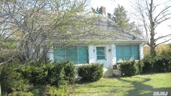 Cute North Fork Style Cape Home In A Farmland Setting!  Hardwood Floors Throughout,  Needs  Tlc.  Detached Garage,  Pretty Property.  Close To The Beach!