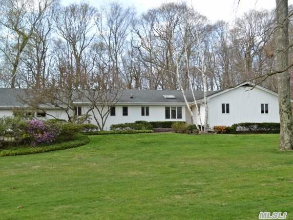 Custom Built 4 Bdrm 3 Bth Ranch In Prime Dix Hills Location. Open Flr Plan; Oversized Lvr, Drm,  Master Bdrm W/Wall To Wall Blt In Closets. Den With Frplc, Blt In Cabinets, Closet, Bar & Ose. Updated Eik W/Hi-Hats & Skylight. Proff. Landcaped Yard W/Sprnklrs. Updated Roof, Heat & Cac. Anderson & Pella Windows. Partially Finished Basement W/Wet Bar.