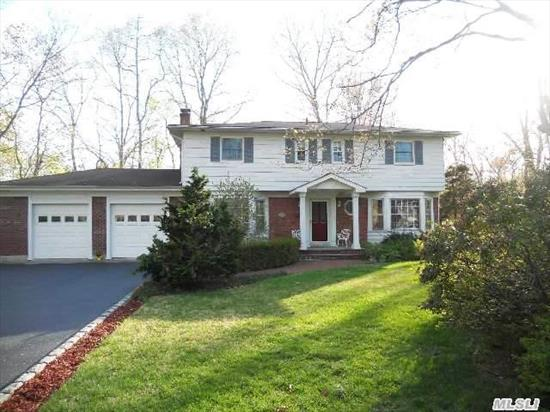 Beautiful Charmer Colonial On .62 Of An Acre In The Desirable Tranquil Forestwood Area Of Smithtown.  4 Bedrms,  2.5 Bths,  Hardwood Floors. Gorgeous Updated Kitch W/ Stainless Appliances,  Granite Counters,  Maple Cabinets And Walls Of Windows Reflect Views Of Your Private Backyard W/ Igp.  Large Master Suite W/ Private Balcony,  Built In's & Fp In Den,  Crown Moldings.