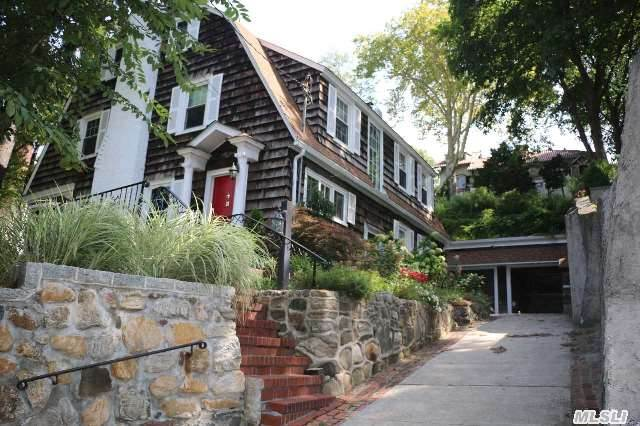 Side Hall Colonial In Douglaston Hills. Five Bedrooms,   2 Fpl's,  2 Car Garage,  68 X 11 Property. Oversized Rooms,  Wood Floors,  1/2 Block To Lirr,  Village And More.