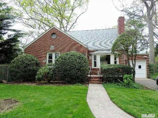 Merrick Woods Expanded Cape,  Freshly Painted,  Wood Floors,  Large Living Room And Dining Room,  Nice Sunroom/Den Off Kitchen,  Nice Size Bedrooms,  Large Lot,  Large Finished Basement,  Lots Of Storage!