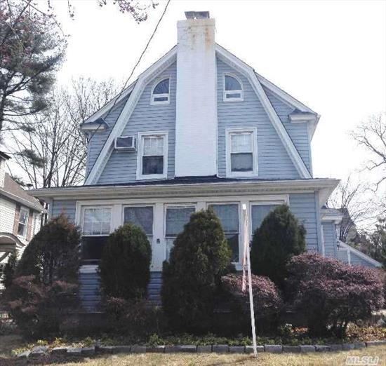 Beautiful Single Family Flushing Side Center Hall Colonial House With R2A Zoning On A 46X100 Lot Features A Full Bsmt W/ Laundry,  Work And Family Room. Sunny Enclosed Porch,  Lr W/Fireplace,  Formal Dr And Eat-In-Kitchen With Stainless Steel Appliances,  3 Bedrooms,  1.5 Baths And An Attic W/ 2 Bedrooms And 1 Bath. New Hardwood Flooring. Private Drwy And 2 Car Garage.
