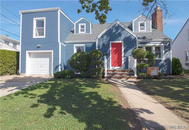 Newly Renovated 5 Bedroom, 4 Bathrooms, Open Floor Plan. New Kitchen With Stainless Steel Appliances, Wood Floors, Wall To Wall Carpeting. New Siding And Roof. Finished Basement With Full Bathroom And Outside Entrance. Move In Ready, Just Bring Furniture