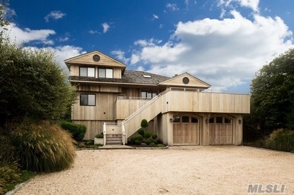 NEW TO MARKET- WESTHAMPTON OCEANFRONT. This totally updated Mint Modern was renovated in 2013, using Mahogany, one of the finest natural hard wood sidings available. This home features beautiful water views from every room. The large great room with open floor plan & wood beam cathedral ceiling supports a Gourmet kitchen, dining area and living area with fireplace. There is a large MBR & marble / porcelain bath overlooking the ocean,3 lovely guest rooms & 2 more modern marble / porcelain, full baths. There are multiple Low Maintenance, Termite Resistant, IPE decks on the ocean & bay side. A sophisticated Creston A/V system throughout, beautiful lighting, 2 car garages, a large parking area, beautiful landscaping & room for a pool, make this new offering a rare buying opportunity. Beautiful landscaping and room for a pool. Jetty protected on the East & West, In addition there is a deeded ROW to the Bay. All this make this new offering a rare buying opportunity.