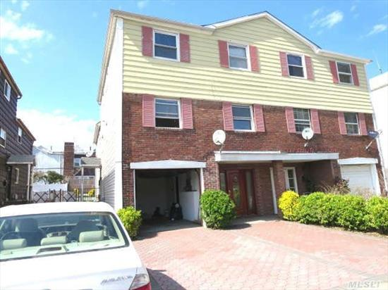 Great 2 Family Semi-Attached,  3 Bedroom/1 Bath Duplex Over 3 Bedroom/ 2Bath Triplex In The Heart Of Oakand Gardens /Bayside Area.  Hardwood Floors Throughout. 2 Central Ac Systems,  2 Hot Water Tanks,  2 Gas And Electric Meters,    Great School District. Near All.