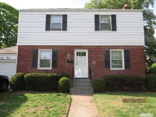 Great Opportunity To Own In Garden City!  Center Entry Colonial With A Wonderful,  Large Yard.  Full Basement/Attached Garage.
