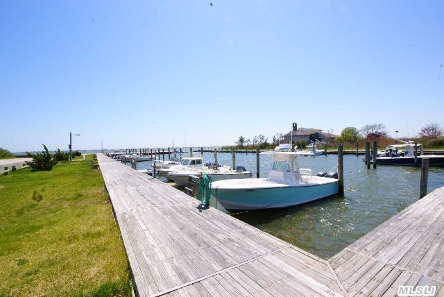 Fantastic Value In Pine Neck Landing. Quiet Boating Community. Updates Throughout -- New Anderson Windows & Doors,  New Insulation,  Sheetrock,  Wiring & 200 Amp Service. New Roof,  Heated Tile Floors In Kitchen,  Updated Bathrooms. Docking Rights Only $350/Yr.