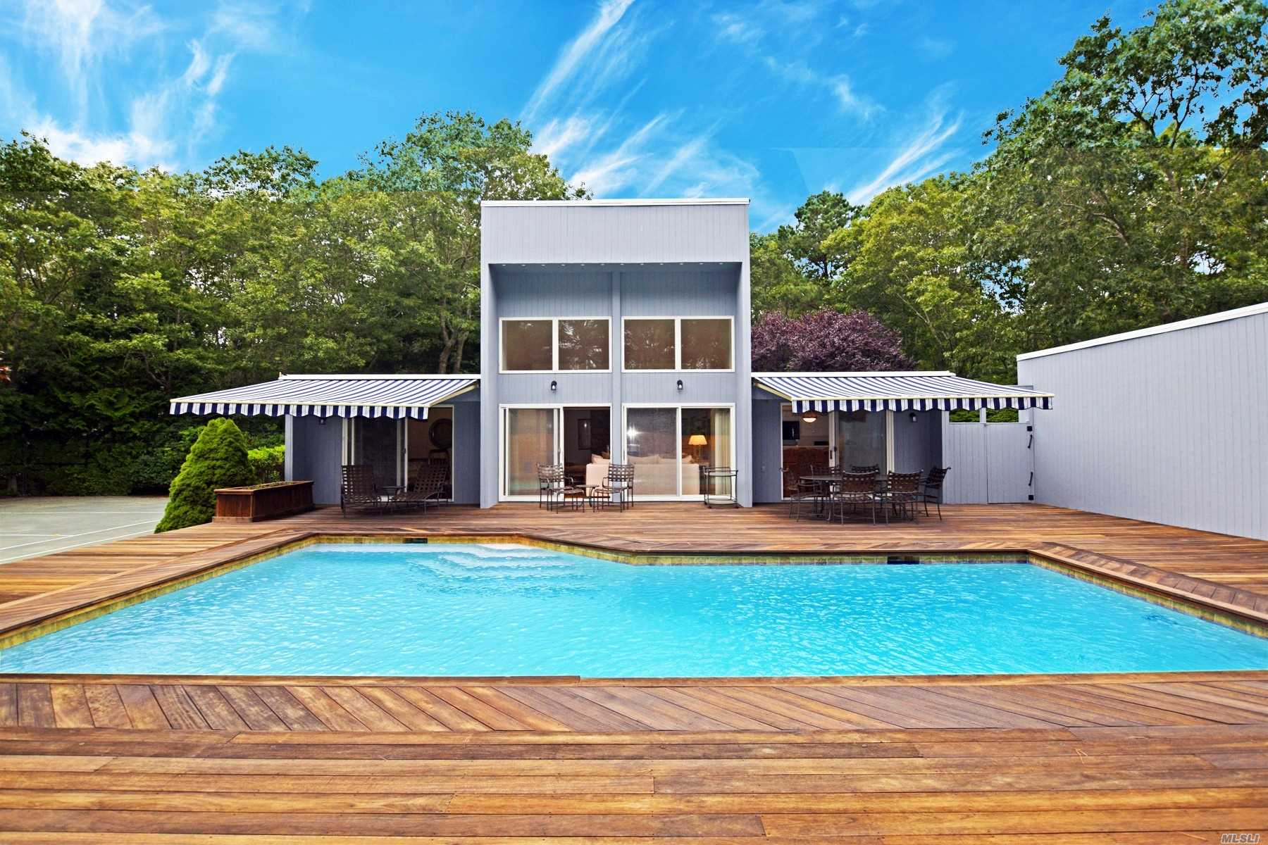 Sought After Quogue Village! This Spacious Contemporary Offers An Open Floor Plan With Eat-In-Kitchen, Family Room With Cathedral Ceilings, Master Suite, En-Suite, Two Guest Bedrooms, Guest Bath, Finished Basement, Detached Garage, Heated Gunite Pool & Har-Tru Tennis. Just Minutes Away From The Famous Quogue Field Club & Village Beach.