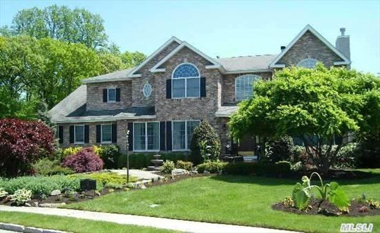 Better Than New 6 Bedroom,  6.5 Bath Brick Colonial Professionally Landscaped With Inground Pool And 6 Car Garage.  2 Story Limestone And Marble Entrance Foyer,  Large Dining Room, Great  Room With Coffered Ceiling And Built In Wood Cabinetry With Fireplace.  Master Suite With Fireplace,  Sitting Room And Dressing Room With Extensive Closets., Jacuzzi And Steam Shower