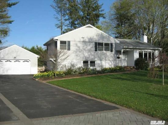 Updated Expanded 3 Bedroom 3 Full Bth Home Offering An Updated Kitchen W/Granite Counters,  Gleaming Hardwood Floors,  Den W/Porcelain Tile & Radiant Heat,  Master Ste W/Updated Bth,  Living Rm W/Gas Fireplace,  & 3 Seasons Rm Wonderful For Entertaining! Additional Updates Inc All Bathrooms,  Burner/Tank,  200 Amp Electric, & Siding. 2 Car Detached Garage