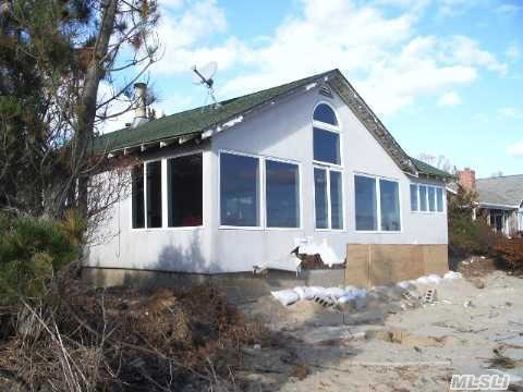 Bayfront Cottage With Panoramic Views. Sandy Bay Beach. Great Room With Fireplace,  Dining Area,  Kitchen,  Laundry Room,  1/2 Bath,  Master Bedroom With Bath. Additional 2 Bedrooms And Bath,  Deck And 2 Car Garage.Permits For Bulkhead Great Potential Boat Slip