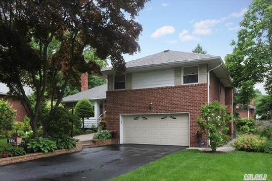 Beautiful & Well Maintained Spacious Split In The Hedges.  Oversized Living Room & Dining Room,  Eik,  Gas Cooking,  Master Bedroom W/Full Bath,  Den W/Fireplace Overlooking Backyard.  Full Finished Basement,  2-Car Garage,  Lovely Landscaped Property Set On A Mid-Block Location.