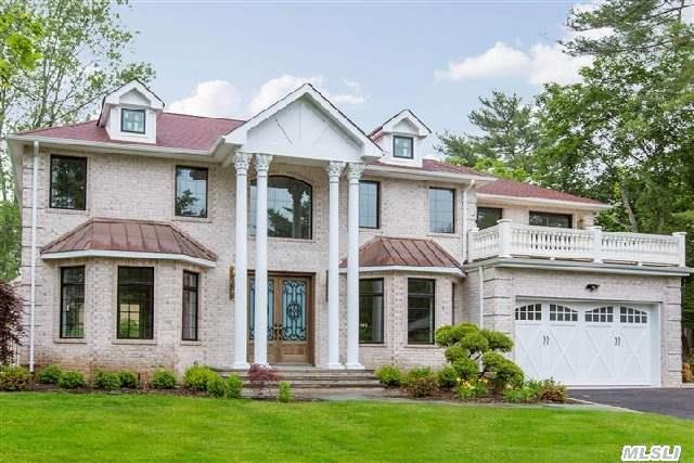 Magnificent Custom Built Brick Colonial Located In The Heart Of Roslyn Country Club. Expert Craftsmanship And Incredible Architectural Details Throughout. Exquisite Moldings,  Gourmet Kitchen With Top-Of-The-Line Appliances,  Lower Level Finished With Exterior Access.