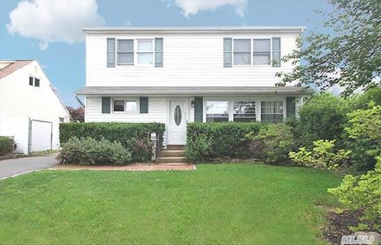 Large Well Maintained Colonial,  One Bedroom On First Floor And Four Large Bedrooms On Second Floor,  2 Full Baths,  Updated. Sliders To Backyard. Large Pull Down Attic.