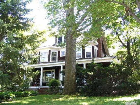 Classic 4 Bedroom Colonial With Front Porch On Huge Flat Lot With 2 Car Garage.  Needs A Touch Of Tlc To Return It Back To Its Former Glory!   Walking Distance To Schools,  Beaches And Village.