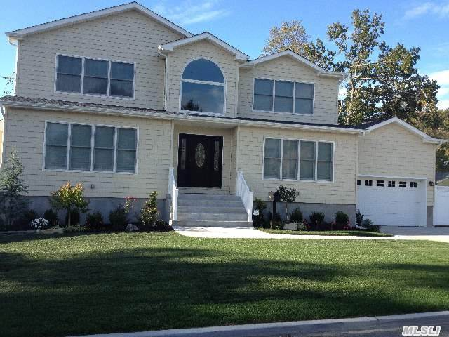 Brand New! Energy Star 4 Bdrm 2 1/2 Bath Custom Colonial On Huge Lot! Granite/Stainless Kitchen W/Center Island,  Family Rm W/Gas Fireplace,  2 Zone Cac. Hardwood Floors,  2nd Floor Laundry,  2 Zone Hydronic Heating,  Custom Moldings. Convenient To Lirr And Shopping,  Near The Village. Kennedy High School