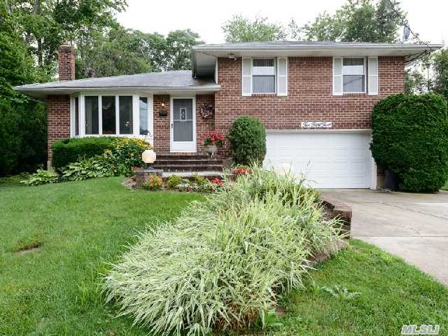This Meticulously Maintained 3 Bedroom,  2 Full Bath Home Is What You Have Been Waiting For! Award Winning Blue Ribbon Syosset School District.  Gas Heat And Gas Cooking,   Updated Kitchen! Den With Wet Bar And Walkout To Yard!  Beautiful Brick Home With Brick Front Steps And Great Private Backyard For Entertaining.