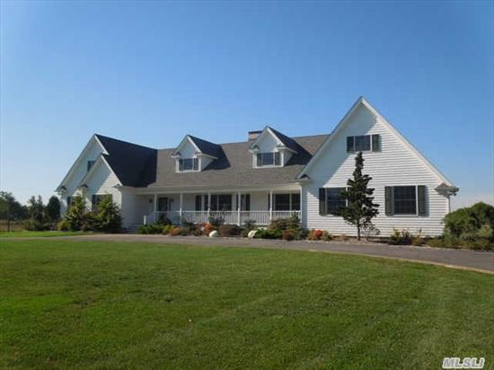Beautifully Appointed Custom Built Home. Elegant In Everyway! Majority Of Living Space On 1st Floor.Borders Preserved Farmland! Close To Iron Pier Beach & Boat Launch. Wonderful Master Suite. Extended Family Quarters On 2nd Level,  Mahogany Front & Back Porches. Radiant Heating On 1st Floor.  Fantastic Home For Large Family Gatherings. Room For A Pool. Beautiful Sunsets.