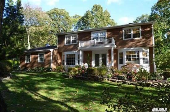 Move Right Into This Immaculate And Beautifully Updated Ch Colonial Featuring: 4 Br,  2.5 Updated Baths,  Updated Eik W/ New Ss Appl,  Flat Fenced Property W/ New Paver Patio & Outdoor Kitchen,  Built-In Firepit,  Heated Gunite Lake Pool W/ Spa,  New Roof,  Cedar Perf. Shakes,  Carriage Garage Doors,  New Igs,  New Gas Burner & Hw Heater,  Hard Wired For Generator & More. A Must See!