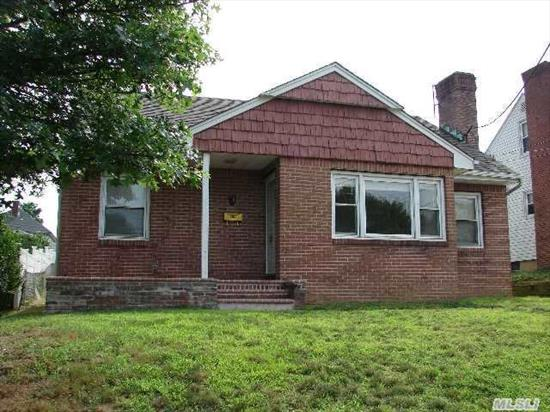 4 Bedroom Expanded Cape. Hardwood Floors,  Wood-Burning Fireplace. Great Bones.  This Home Is Being Sold As Is.