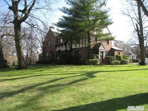 Enlgish Tudor Set On 1/3 Of An Acre Of Land.  Old World Charm And Custom Detailing Throughout.  Oak Floors,  French Doors,  Lots Of Updates.