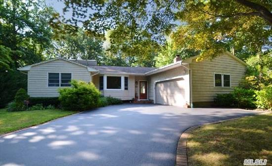 Lovely 3/4 Br Ranch In Desirable North Smithtown! This Home Features A New Granite,  Custom Eik W/Cherry Cabinets,  Ss Appliances & Center Island, 2 Updated Baths,  Den(Can Be 4th Br), Spacious Formal Dining Room,  Living Room W/Fp, Hw Floors, Finished Basement + Storage Area, Cac, Alarm, Vinyl Siding &  Igs! Set On 1/2 Acre Of Park Like Property In Beautiful,  Quiet Neighborhood!
