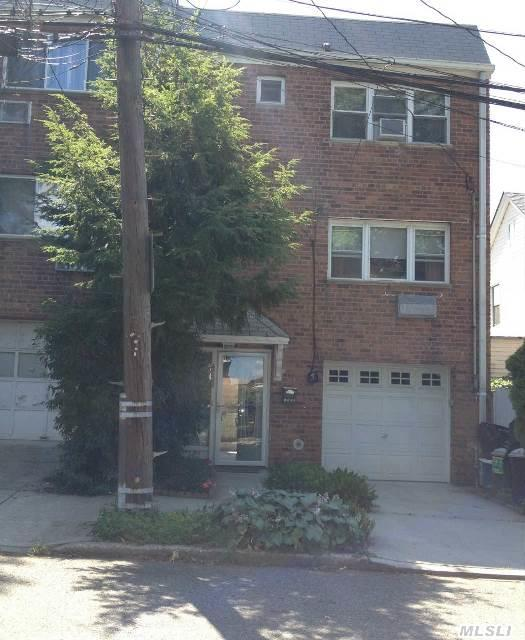 Fabulous Three Bedroom Semi-Attached End Unit On Highly Desireable And Centrally Located Site In Bayside.  New Kitchen With Granite Counter-Tops,  Wood Floors Throughout,  Newly Painted,  Hi Hats In Living Room And Dining Room,  Close To Shopping And The Long Island Railroad Station.