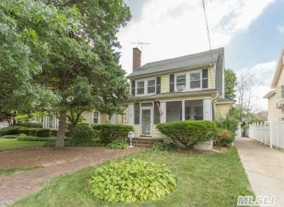 This Cozy Colonial Is  A Commuters Dream Located  Only Blocks Away From The Lirr.  Home Features An  Open Floor Plan  Through Out First And Second Floors With All Hardwood Floors And Spacious Sun Drenched Rooms. Basement Level Also Finished As Bonus Recreational Space. Currently Used As A One Family Residence,  However Is Zoned In A Two Family District With Potential .