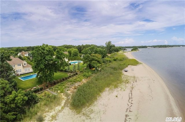 'Paradise By The Bay'. Custom Built Home W/ 5 Beds, 4.5 Baths. 211Ft Of Sugar Sand Bay Beach With Open Views Of The Peconic Bay & Shelter Island Beyond. New Heated Gunite Pool On The Waterside. Plenty Of Room For Entertaining. Beautiful Location!