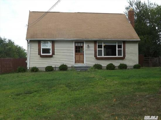 Updated 4 Bedroom Cape,  New Kitchen W/Maple Cabinets,  S/S Appliances And Granite Countertops,   Hardwood Floors,  Updated Baths Newer Heating System,  Outside Entrance From Basement. Just Shy 1 Acre Has Deck & Shed.  Close To Shopping,  Outlets,  Wineries 2 % Peconic Tax Applies Rm Upstairs For 1/2 Bath
