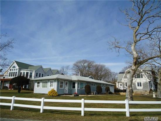 Wonderful Light Filled 3 Bedroom, 2 Bathroom Ranch With Water Views Of Corey Creek, Moyle Cove, And The Peconic Bay. Included In The Sale Is 2340 Minnehaha Blvd., A Waterfront .20 Acre Lot (W/ Bulkhead & Dock), Across The Street. True Taxes For Both Properties: $8079.88 W/O Star. Both Properties Are Part Of Laughing Water Property Owners Assoc..$185.00 Fee/Year. Fantastic!