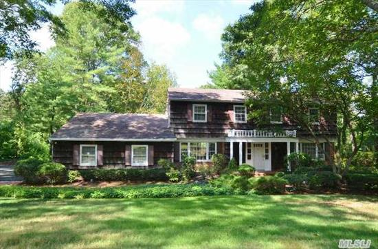 Wonderful 5Br 3Bth Center Hall Colonial Situated On Park Like Property.  Featuring Beautiful Hardwood Floors,  Formal Dr,  Formal Lr,  Den W/Fpl,  Eik,  Mudrm,  And Nanny Qtrs. Master Suite W/ Dressing Area & Wic. 3 Addtl Large Bedrooms,  And Full Unfinished Bsmt W/ Ose. Brick Walkway That Leads To 2 Patios And 20X40 Ig Pool. Hhsd #5,  East. Taxes W/Star $14609. See Virtual Tour!
